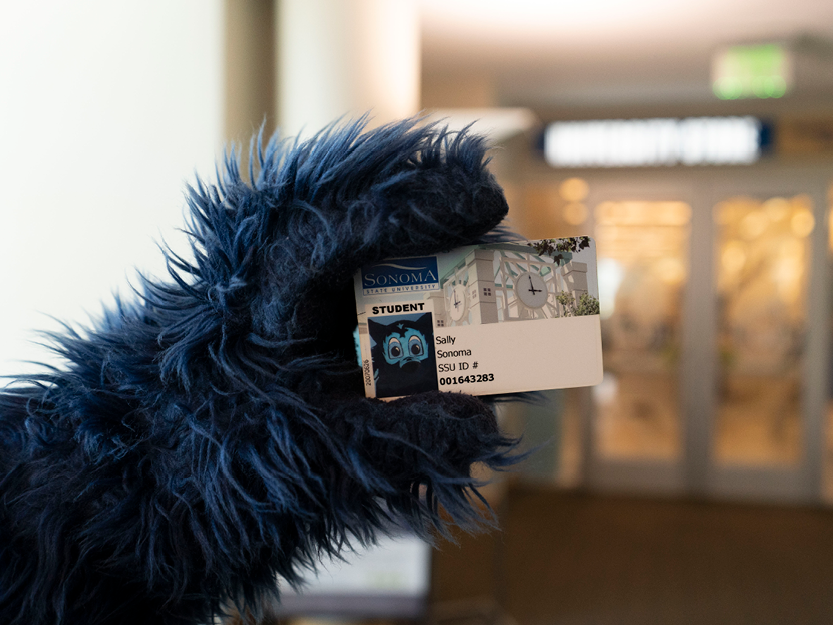Lobo holding Seawolf ID Card